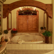 Rustic Bathroom by Quilter Construction & Remodeling