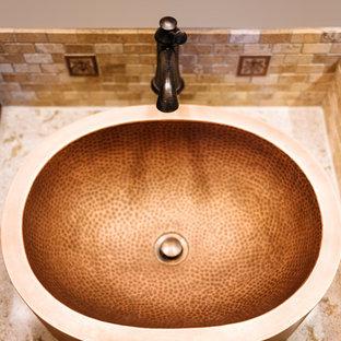 バンクーバーのラスティックスタイルのおしゃれなマスターバスルーム (インセット扉のキャビネット、ヴィンテージ仕上げキャビネット、ダブルシャワー、マルチカラーのタイル、石タイル、白い壁、スレートの床、ベッセル式洗面器、珪岩の洗面台) の写真