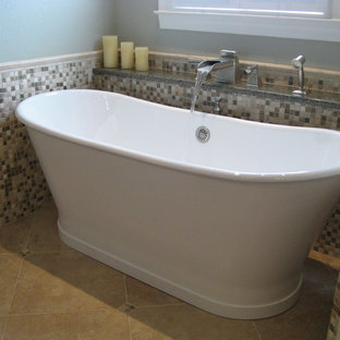 Photo of a traditional bathroom in Birmingham with mosaic tiles.