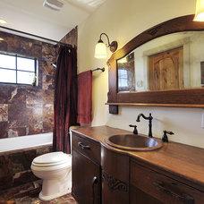 Traditional Bathroom by Capstone Custom Homes