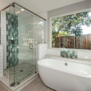 Bathroom - mid-sized contemporary master multicolored tile and porcelain tile plywood floor and beige floor bathroom idea in Los Angeles with shaker cabinets, dark wood cabinets, a one-piece toilet, beige walls, an integrated sink, solid surface countertops and white countertops