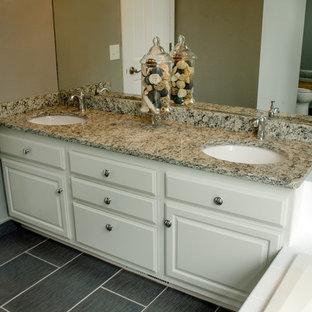 Свежая идея для дизайна: большая главная ванная комната в классическом стиле с плоскими фасадами, белыми фасадами, накладной ванной, открытым душем, серой плиткой, керамической плиткой, серыми стенами, полом из керамической плитки, накладной раковиной, столешницей из гранита и серым полом - отличное фото интерьера