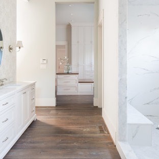 Photo of a large country master wet room bathroom in Atlanta with recessed-panel cabinets, grey cabinets, a japanese tub, white tile, marble, blue walls, medium hardwood floors, an undermount sink, marble benchtops and an open shower.