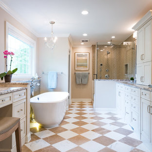 Example of a huge classic master black and white tile and marble tile marble floor and white floor bathroom design in Chicago with recessed-panel cabinets, beige cabinets, a one-piece toilet, beige walls, an undermount sink, quartzite countertops and a hinged shower door