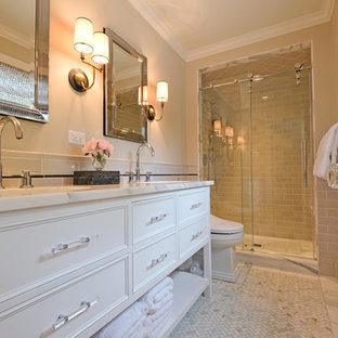 Mid-sized transitional master beige tile and ceramic tile marble floor alcove shower photo in Chicago with white cabinets, beige walls, an undermount sink, recessed-panel cabinets, marble countertops and a one-piece toilet