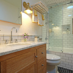 Small transitional white tile and subway tile ceramic tile bathroom photo in Chicago with medium tone wood cabinets, white walls, an undermount sink, shaker cabinets, marble countertops and a one-piece toilet