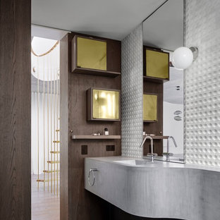 This is an example of a contemporary bathroom in Sydney with gray tile, white tile, white walls, an integrated sink, concrete benchtops, grey floor and grey benchtops.