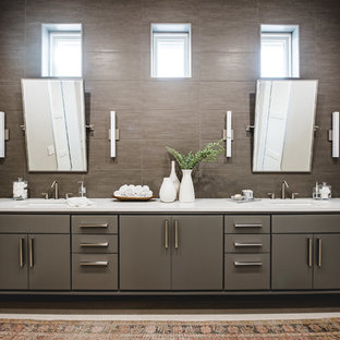 Bathroom - mid-sized contemporary master brown tile and stone tile travertine floor bathroom idea in Austin with flat-panel cabinets, gray cabinets, gray walls, an undermount sink and white countertops