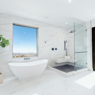 Example of a huge 1960s master white tile white floor and marble floor bathroom design in Los Angeles with white countertops and white walls