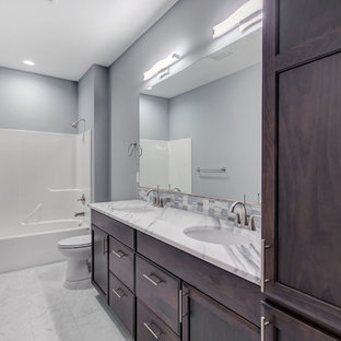 Inspiration for a mid-sized transitional kids' gray tile and glass tile porcelain floor and white floor bathroom remodel in Seattle with recessed-panel cabinets, dark wood cabinets, a two-piece toilet, gray walls, an undermount sink and marble countertops