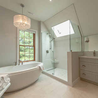 Inspiration for a large contemporary master white tile and porcelain tile porcelain floor bathroom remodel in Toronto with beaded inset cabinets, gray cabinets, a one-piece toilet, gray walls, an undermount sink and engineered quartz countertops