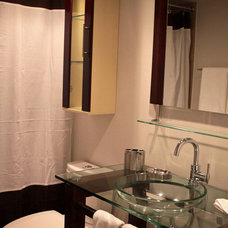 Modern Bathroom by Before and After Homes