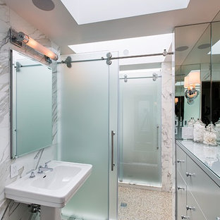 Inspiration for a contemporary bathroom remodel in New York with a pedestal sink, flat-panel cabinets and white cabinets