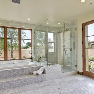 Design ideas for a mediterranean ensuite bathroom in Los Angeles with dark wood cabinets, a built-in bath, a corner shower, white tiles, beige walls, white floors, a hinged door and white worktops.