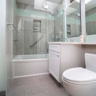 Bathroom - small contemporary 3/4 glass tile and blue tile ceramic floor and gray floor bathroom idea in San Francisco with recessed-panel cabinets, white cabinets, a two-piece toilet, gray walls, an undermount sink, quartz countertops and a hinged shower door