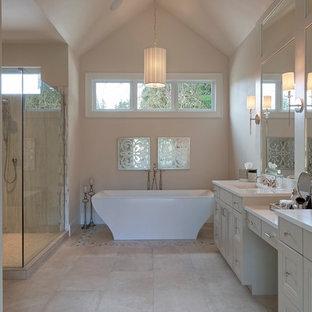 Inspiration pour une salle de bain principale traditionnelle de taille moyenne avec un placard à porte affleurante, des portes de placard beiges, une baignoire indépendante, une douche d'angle, du carrelage en travertin, un mur beige, un sol en travertin, un lavabo encastré, un plan de toilette en marbre, un carrelage beige, un sol beige et une cabine de douche à porte battante.