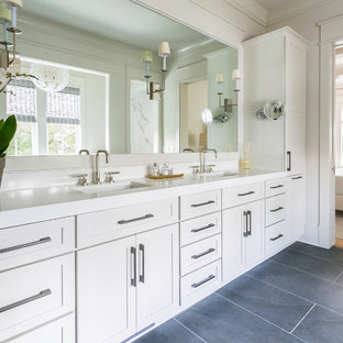 Bathroom - coastal gray floor bathroom idea in Charleston with shaker cabinets, gray cabinets, white walls, an undermount sink and white countertops