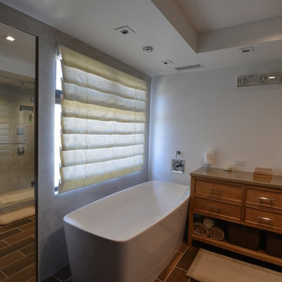 Example of a mid-sized minimalist master brown tile porcelain tile bathroom design in Los Angeles with beaded inset cabinets, medium tone wood cabinets, a two-piece toilet, white walls, a vessel sink and solid surface countertops