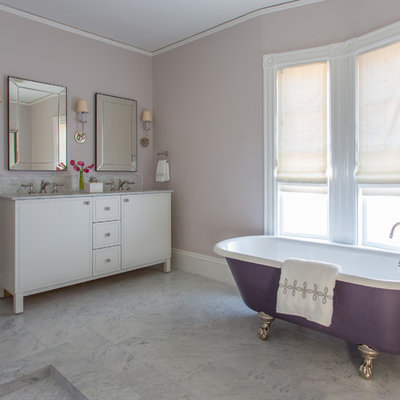 Mid-sized transitional master white tile claw-foot bathtub photo in Boston with white cabinets, marble countertops, flat-panel cabinets, purple walls and an undermount sink