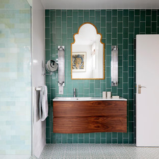 This is an example of a small contemporary master bathroom in London with flat-panel cabinets, brown cabinets, an undermount tub, an open shower, a one-piece toilet, green tile, porcelain tile, white walls, porcelain floors, a drop-in sink, green floor, an open shower, white benchtops, a double vanity and a floating vanity.
