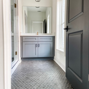 Design ideas for a mid-sized transitional 3/4 bathroom in Atlanta with shaker cabinets, grey cabinets, a double shower, a one-piece toilet, white tile, subway tile, white walls, mosaic tile floors, a drop-in sink, engineered quartz benchtops, grey floor, a hinged shower door, white benchtops, a single vanity, a built-in vanity and brick walls.