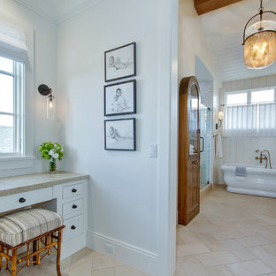 Inspiration for a large farmhouse master white tile and subway tile travertine floor and beige floor bathroom remodel in Orange County with shaker cabinets, white cabinets, a two-piece toilet, white walls, an undermount sink, quartzite countertops, a hinged shower door and beige countertops