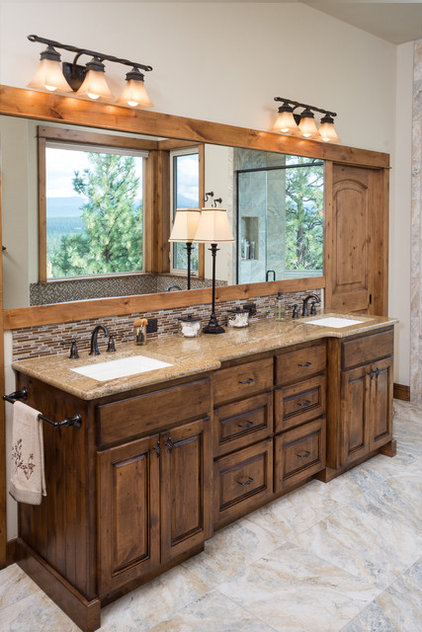 Rustic Bathroom by Sun Forest Construction