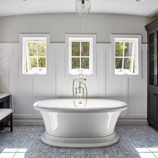 Inspiration for a transitional master freestanding bathtub remodel in Los Angeles with shaker cabinets and black cabinets
