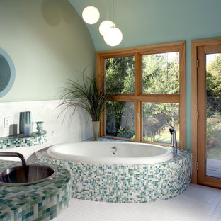 Design ideas for a contemporary bathroom in Milwaukee with a drop-in sink, tile benchtops, a drop-in tub, multi-coloured tile, mosaic tile and turquoise benchtops.