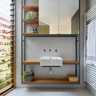 Inspiration for a scandinavian 3/4 bathroom in Melbourne with open cabinets, white tile, a wall-mount sink, wood benchtops, white floor and brown benchtops.