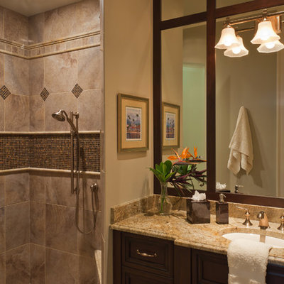 Inspiration for a mid-sized timeless 3/4 gray tile and porcelain tile porcelain tile and beige floor alcove shower remodel in Miami with granite countertops, an undermount sink, recessed-panel cabinets, dark wood cabinets and beige walls