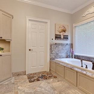 Idee per una grande stanza da bagno padronale classica con ante con riquadro incassato, ante beige, vasca da incasso, piastrelle multicolore, piastrelle in travertino, pavimento in gres porcellanato, top in granito, porta doccia a battente, pareti beige, pavimento beige e top beige