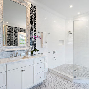 Example of a large transitional master white tile and subway tile porcelain floor, gray floor and single-sink bathroom design in Miami with recessed-panel cabinets, white cabinets, an undermount sink, gray countertops, a niche and a built-in vanity
