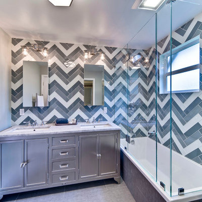 Bathroom - mid-sized transitional master multicolored tile and glass tile ceramic tile bathroom idea in San Francisco with an undermount sink, marble countertops and gray walls