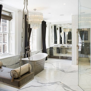 Inspiration for a contemporary bathroom in London with stone slabs and marble worktops.