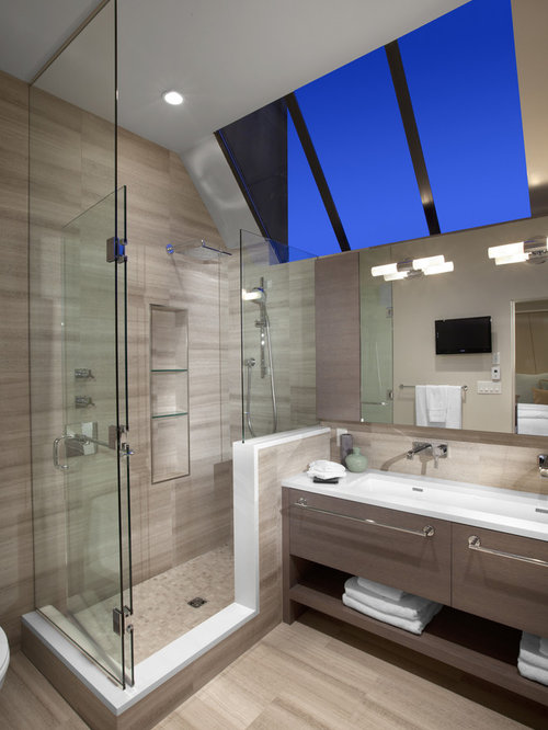 Corner shower design in vancouver with a trough sink and open cabinets