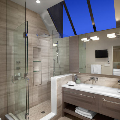 Example of a large trendy master beige tile and porcelain tile porcelain tile corner shower design in Vancouver with a trough sink, open cabinets, gray cabinets, beige walls and quartz countertops