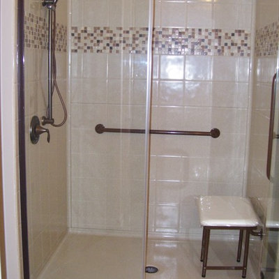 Walk-in shower photo with a hinged shower door