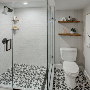 Inspiration for a small rustic master white tile and subway tile cement tile floor and multicolored floor corner shower remodel in DC Metro with a two-piece toilet, white walls and a hinged shower door