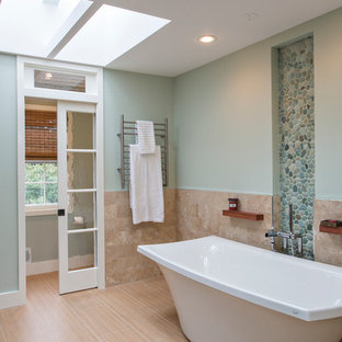 Example of a large beach style master beige tile and ceramic tile freestanding bathtub design in DC Metro with blue walls