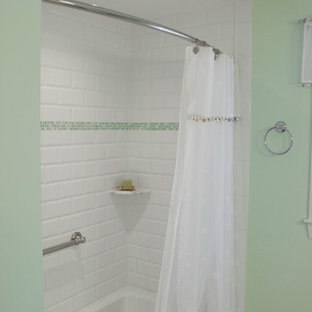 Bathroom - mid-sized transitional kids' white tile and porcelain tile ceramic floor bathroom idea in Boston with raised-panel cabinets, white cabinets, a one-piece toilet and green walls