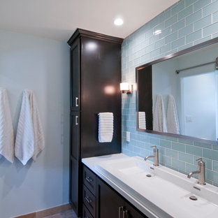 Inspiration for a large timeless 3/4 blue tile and subway tile double-sink bathroom remodel in Los Angeles with recessed-panel cabinets, dark wood cabinets, blue walls, a trough sink, solid surface countertops, white countertops and a built-in vanity
