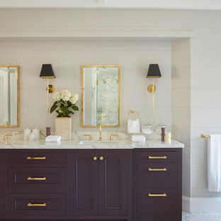Photo of a mid-sized transitional master wet room bathroom in Los Angeles with shaker cabinets, purple cabinets, a freestanding tub, a two-piece toilet, white tile, marble, an undermount sink, marble benchtops and a hinged shower door.