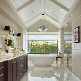 Photo of a mid-sized traditional master bathroom in Los Angeles with purple cabinets, a freestanding tub, white tile, marble, an undermount sink, marble benchtops, a hinged shower door, recessed-panel cabinets, an alcove shower, beige walls and white floor.