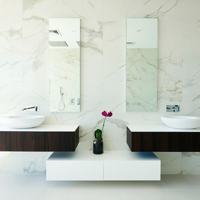 Trendy stone tile bathroom photo in Perth with a vessel sink and flat-panel cabinets