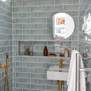 Design ideas for a classic bathroom in London with grey tiles, ceramic tiles and a wall-mounted sink.
