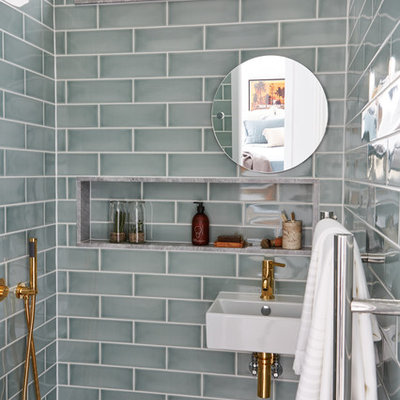 Example of a transitional master gray tile and ceramic tile wet room design in London with a wall-mount sink
