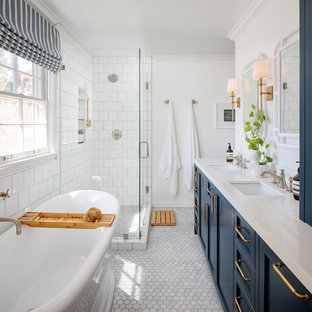 Example of a mid-sized beach style master white tile and ceramic tile marble floor, gray floor and double-sink bathroom design in San Francisco with shaker cabinets, blue cabinets, white walls, an undermount sink, quartz countertops, a hinged shower door, white countertops and a niche