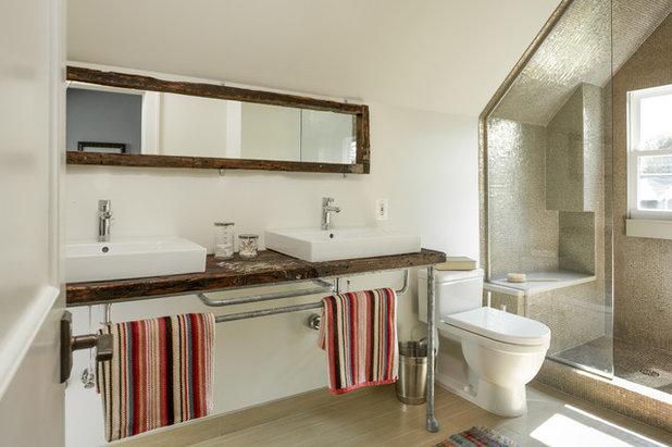 Industrial Bathroom by McIntosh Poris Associates