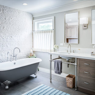 Bathroom - large transitional master white tile and stone tile porcelain floor and brown floor bathroom idea in Detroit with flat-panel cabinets, dark wood cabinets, an undermount sink, white countertops, beige walls, engineered quartz countertops and a hinged shower door